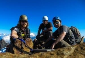 Veterans Dan Wiwczar, Derek Quintanilla, and Joshua Brandon on the summit of Mt. Olympus in Washington State.